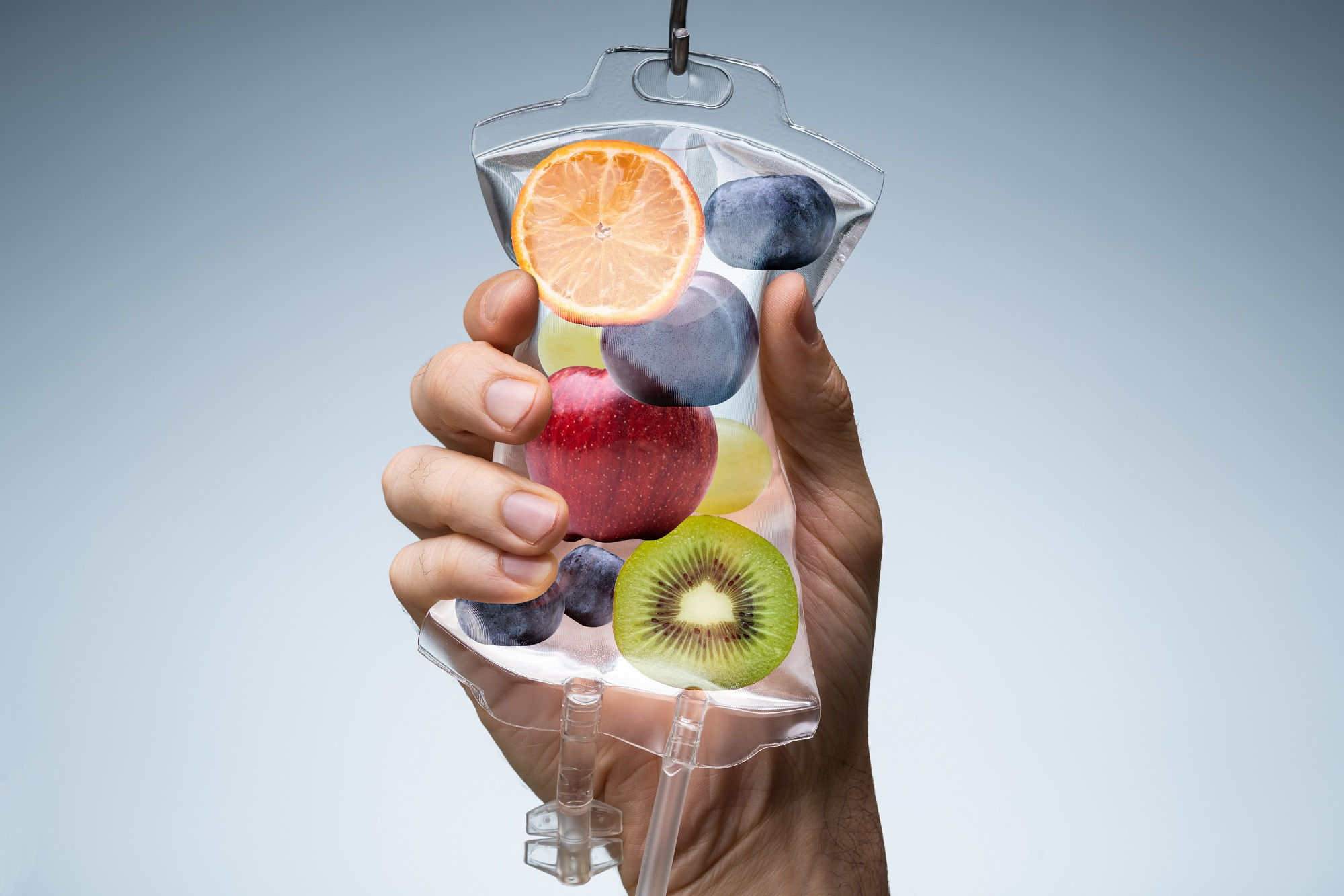A hand holding IV Vitamin therapy
